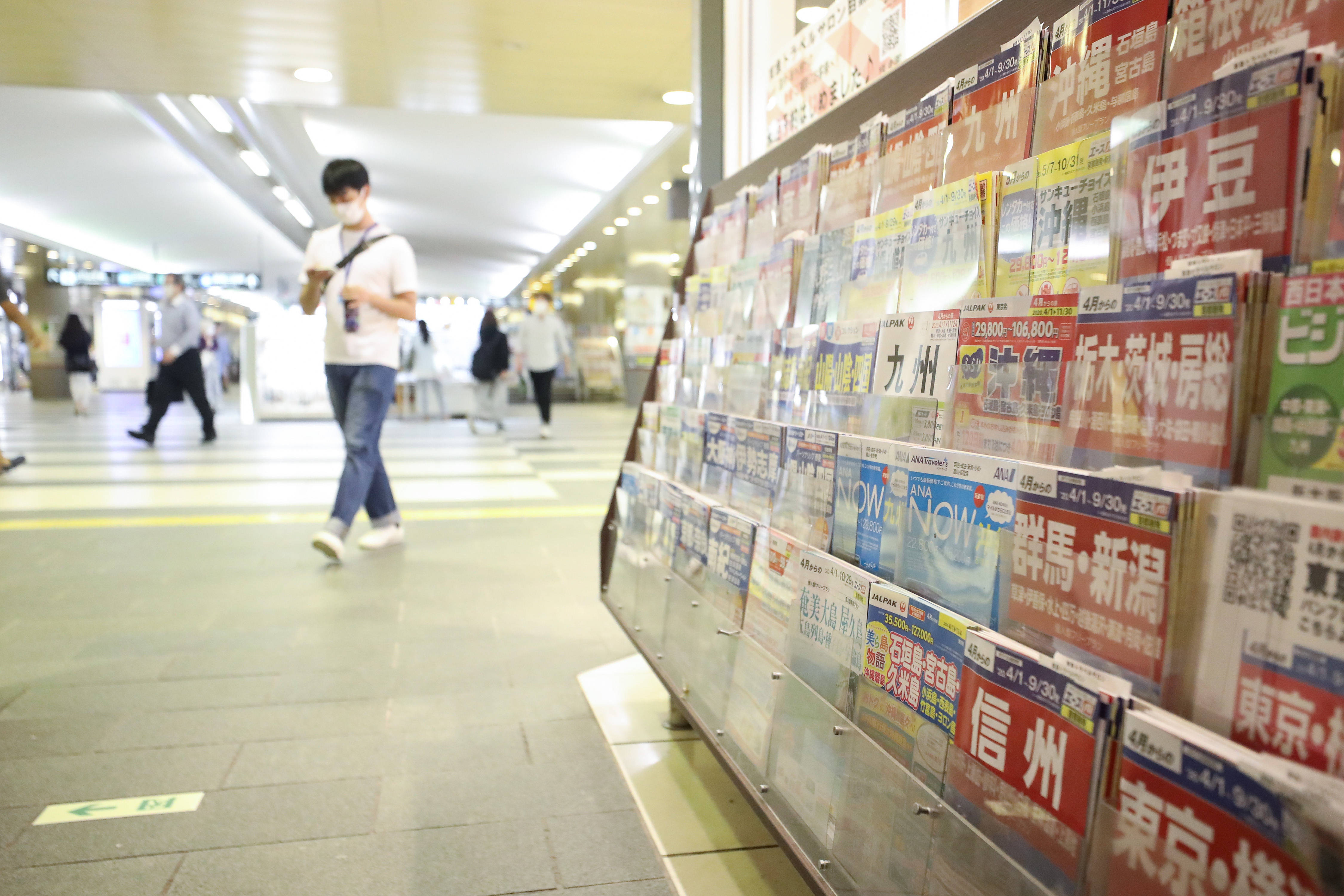 财经观察:振兴国内游促日本旅游业复苏引争议